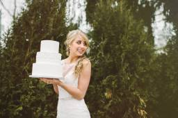 bride and cake with trees background