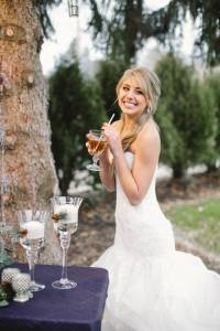 greens bride smiling rl wilson outdoor reception